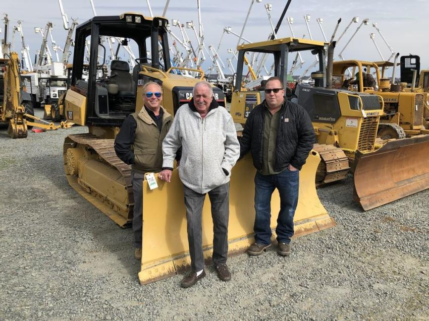 Looking over a Cat D3K (L-R) are Dan Wilcox and Andy Drydurgh of Wilcox Tractor Sales in Charlotte, N.C., and Brian LaBonte of Rampco Construction in Dudley, Mass.