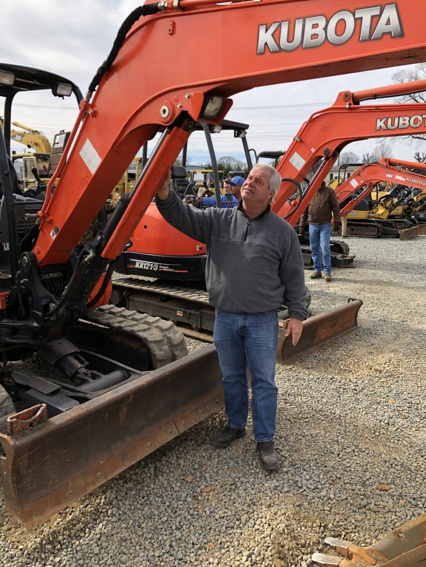 Kevin Key of Lyn-Rich Contracting in West Columbia, S.C., looks over the Kubota excavators.