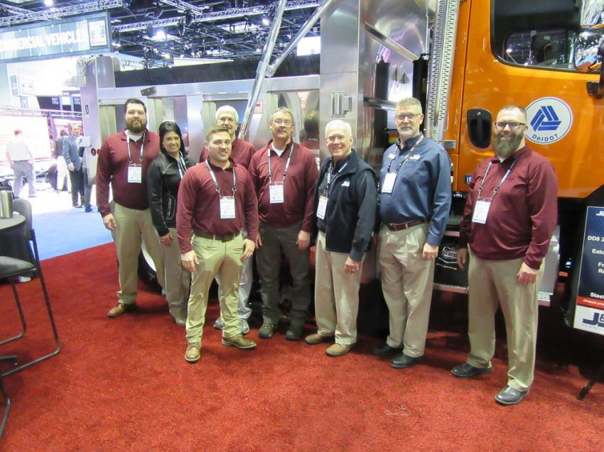 (L-R): J&J Truck Bodies & Trailers' Ryan Young, Kim Stenger, Larry Faidley, Jason Cornell, Ed Lyons, Bill Riggs, David Spear, and Nate Weaver were ready to discuss the company's lineup of dump bodies, trailers, service trucks and upfitting equipment, as well as the company's custom fabrication capabilities at the show.