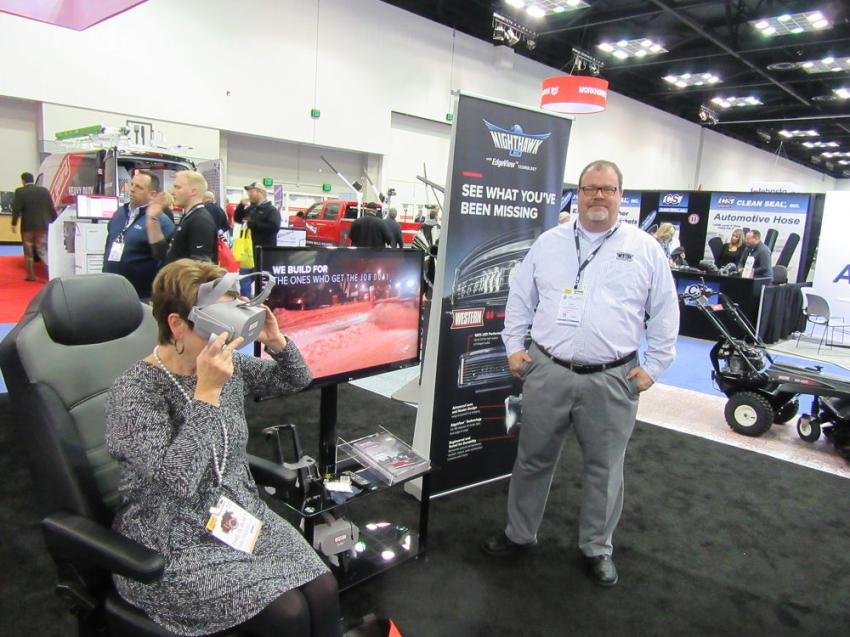 At the Western Product's booth, Doug Clark oversees a virtual demonstration of the company's all new Intensifire LED headlamps with exclusive EdgeView technology.