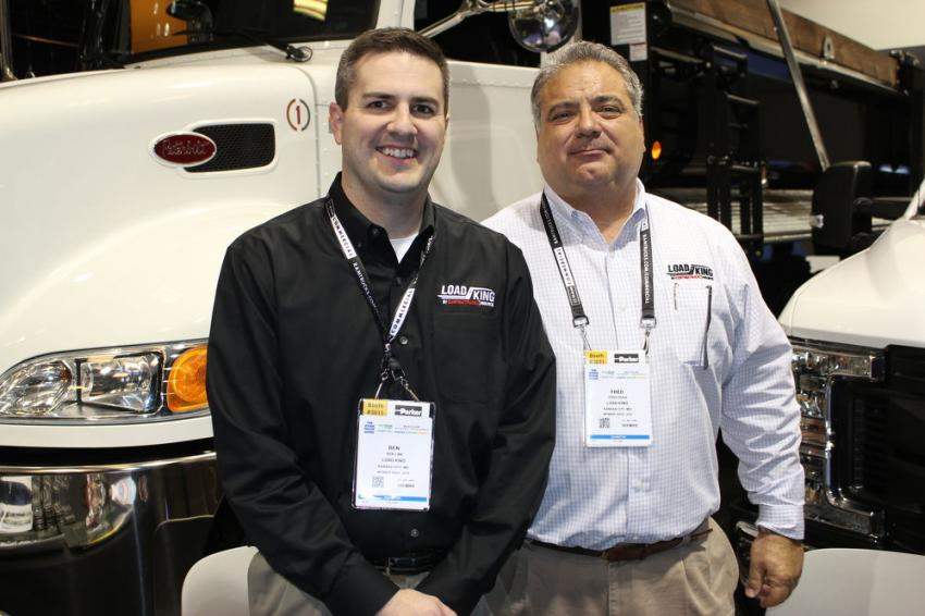 At the Load King booth at NTEA are Ben Link (L), executive vice president, and Fred Ross, CEO, both of Custom Truck One Source.