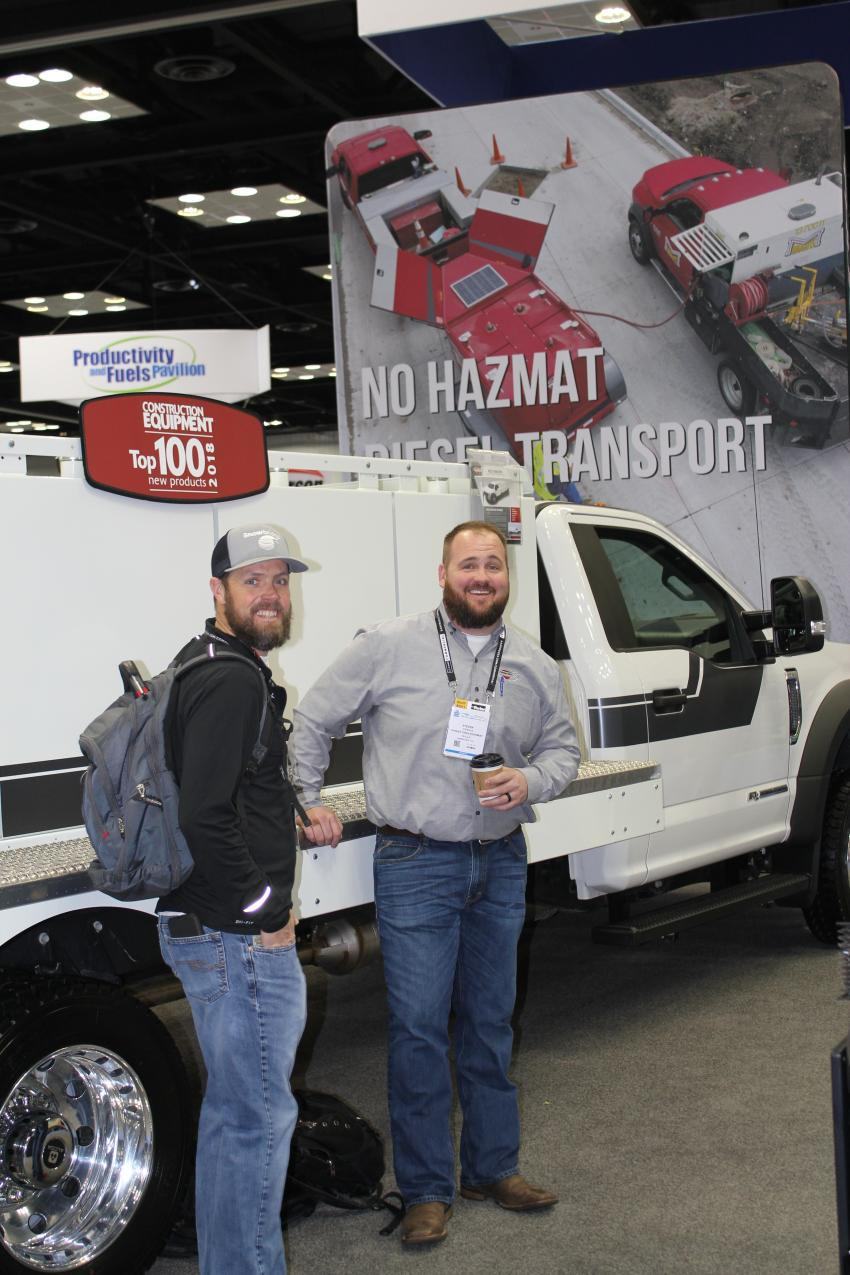 Chris Tatro of Snowbridge Inc., Breckenridge, Colo., speaks with Steven Ile, Thunder Creek product specialist of Pella, Iowa, about the features on the MTU920.