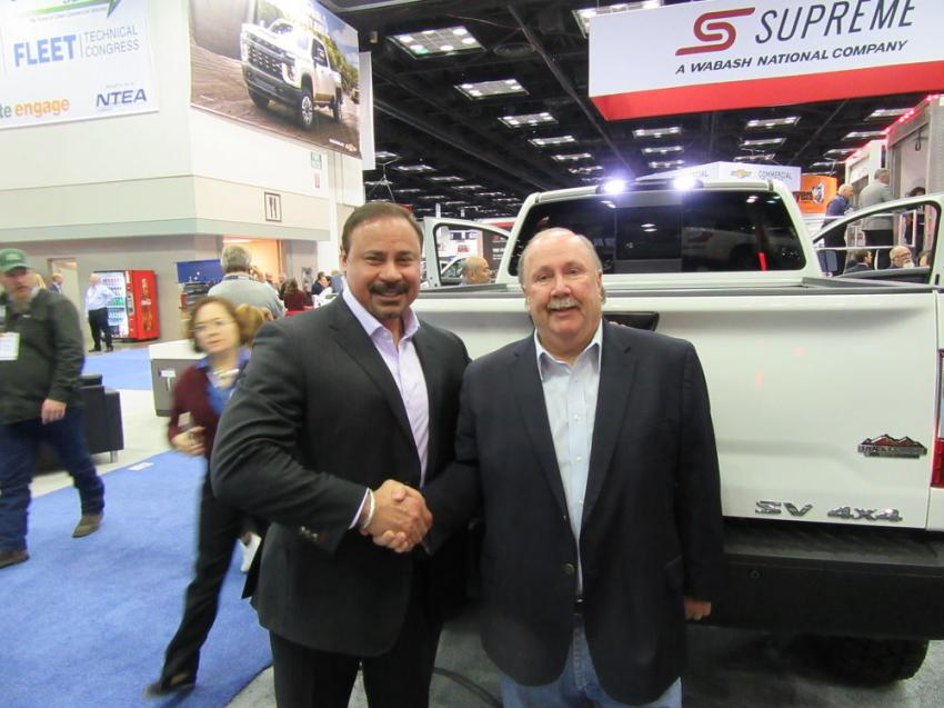 Fred DePerez (L), Nissan's vice president, light commercial vehicles, and Rock Ridge Trucks CEO Burl Outlaw shake on their new agreement to offer Nissan trucks with Rock Ridge upfitted packages with matched warranties.