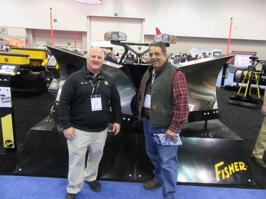 Fisher Engineering's Norm Klimko (L) catches up with Dave Shirn of Shirns to discuss the company's latest snow and ice maintenance equipment.