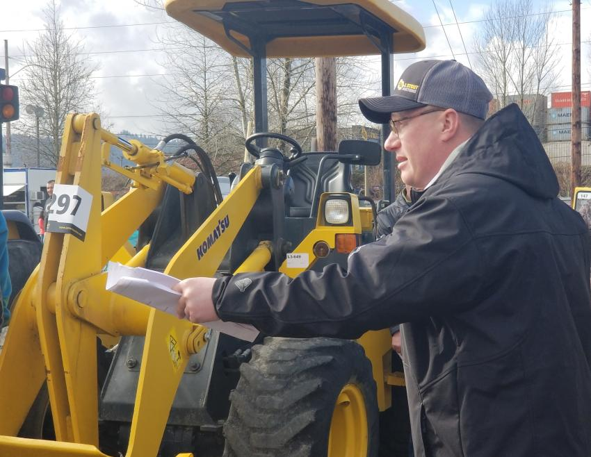 Ringman Dan Gross is taking bids for a 2009 Komatsu W40-6 wheel loader at the March auction.