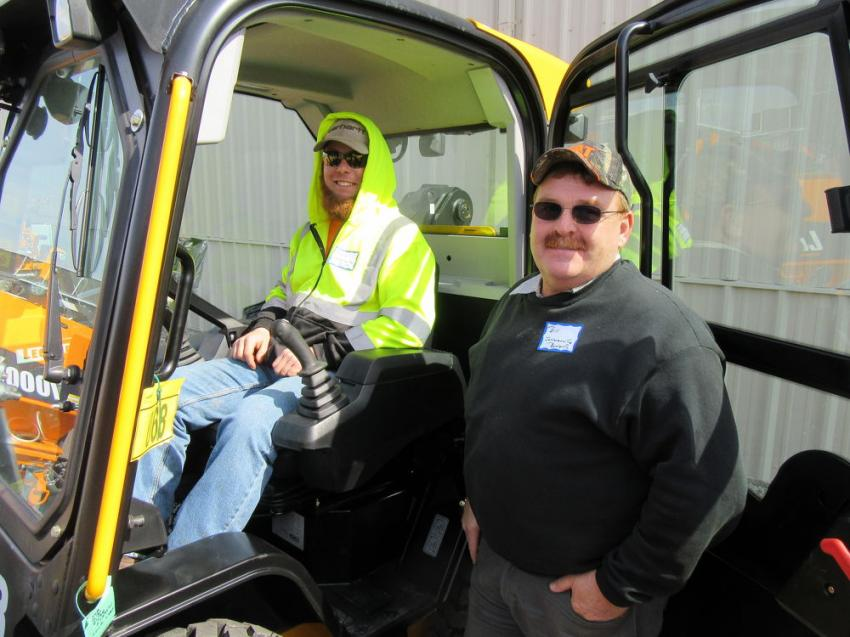 Austin Taylor (L) and Bill Foertsch check out this JCB 270 skid steer loader with side entry.