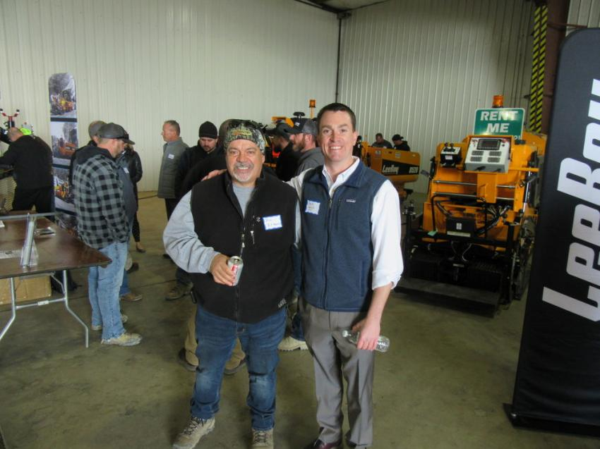 Brad Katchmarchi of BK Asphalt Paving gets an enthusiastic thank you from Stephenson Equipment's Charlie Walsh for the purchase of a LeeBoy 8510 asphalt paver, which he picked up on the previous Friday. Katchmarchi has been a friend and customer of Walsh and his family for 30 years.