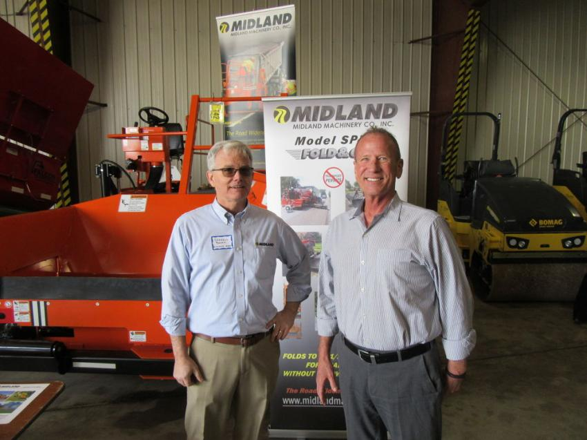 Darrell Banks (L) of Midland Machinery speaks with Stephenson Equipment President Dennis Heller.
