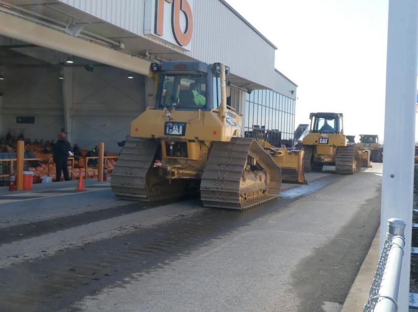 Caterpillar crawler dozers move over the ramp during the auction.