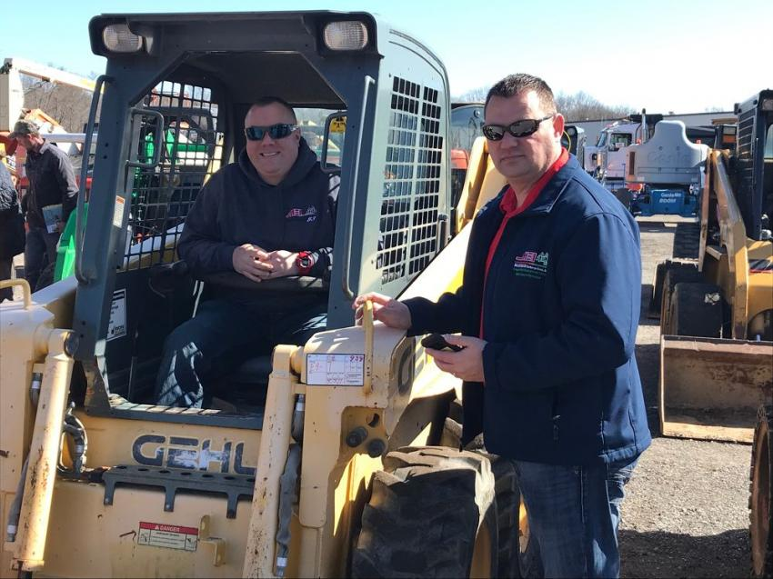 Checking out the skid steers are Jason Joseph (L) and Nathan McCutcheon, both of MEI Enterprises Inc., Apollo, Pa., and Houston, Pa.