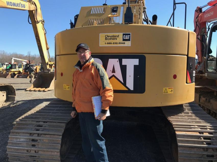 Ron Copenhaver from Lebanon, Pa., looks over the hydraulic excavators.