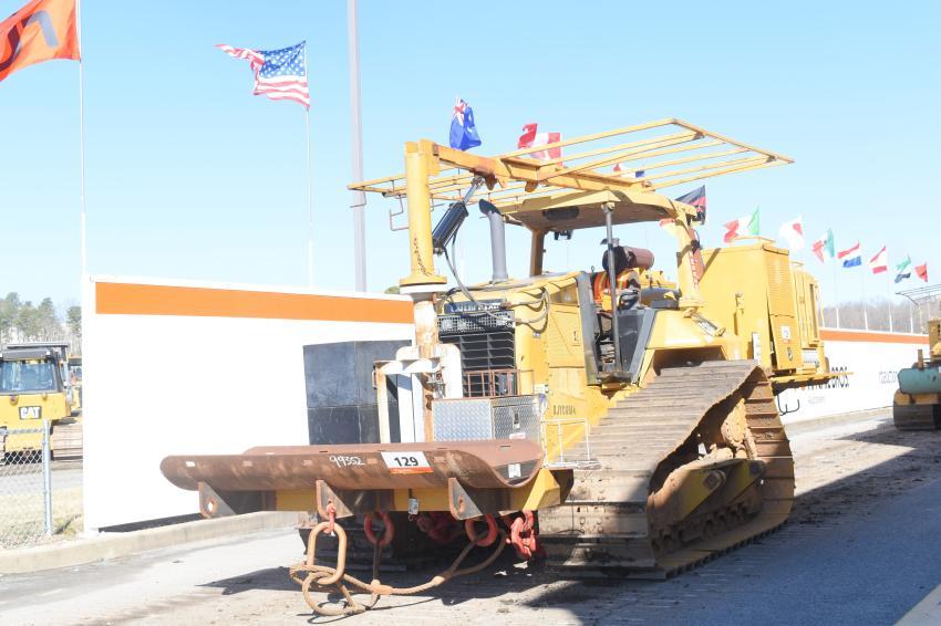 Caterpillar tack tractors with Vanguard welders roll over the auction ramp.