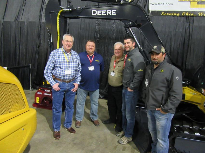 (L-R): Leslie Equipment's John Grow and Bob Runions, along with Allied Construction Products' Rich Steinbrenner and Leslie Equipment's Pete Culicerto and Jason Belisle, welcome attendees to discuss the company's John Deere equipment at the show.