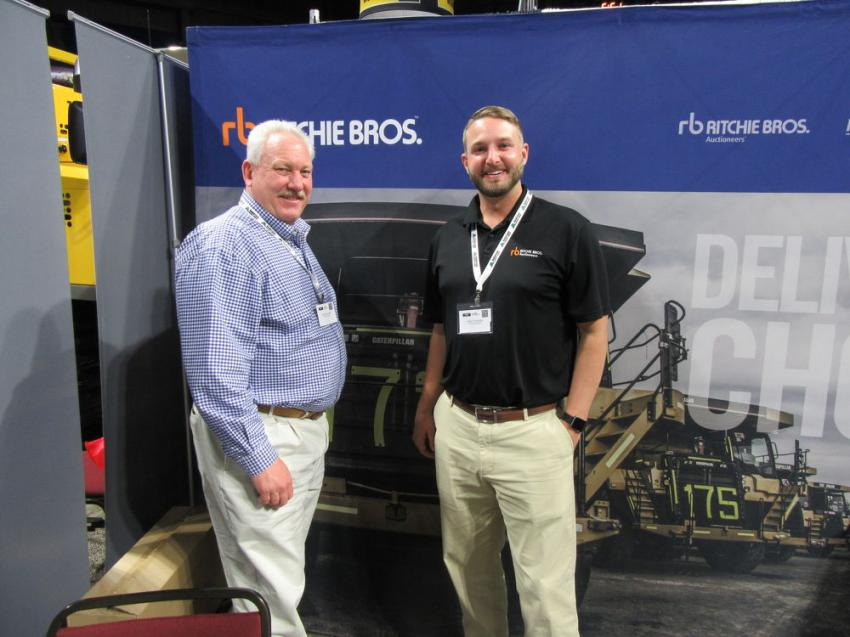 Ritchie Bros.' Todd Meadows (L) and Phillip Riner spoke with attendees about upcoming auctions and how to convert old yellow iron into gold at the show.