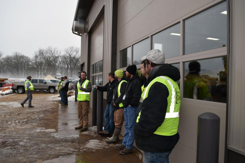 Customers line up to operate the intelligent excavators.