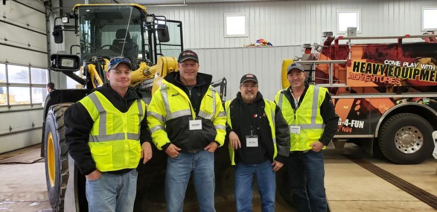 "(L-R): Chris Peterson of C.J. Moyna with Brad Jahnke and Scott Rouse, both of Ulland Brothers, and their RMS territory manager, Jeff Bistodeau. ""This is a great event — lots of equipment you can get in and test, see how it performs. We'll be back again,"" said Peterson."