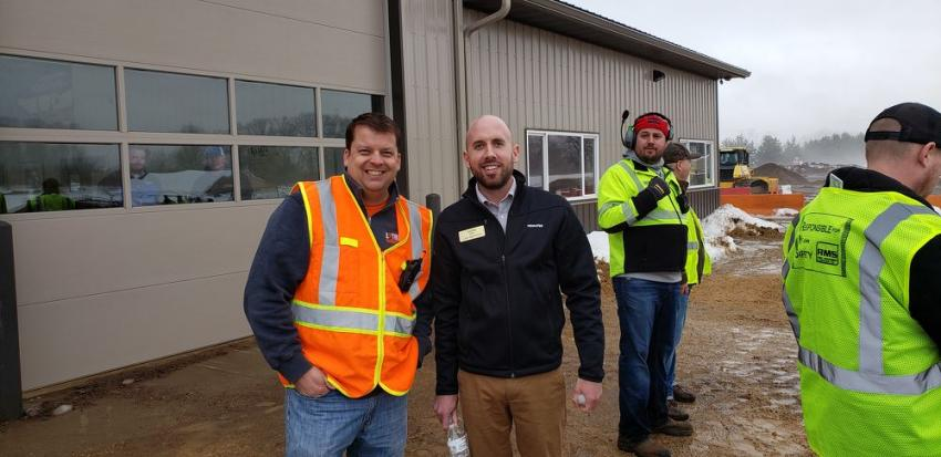 Randy Stenger (L), founder and CEO of Extreme Sandbox, speaks with Komatsu district manager Justin Sailer.
