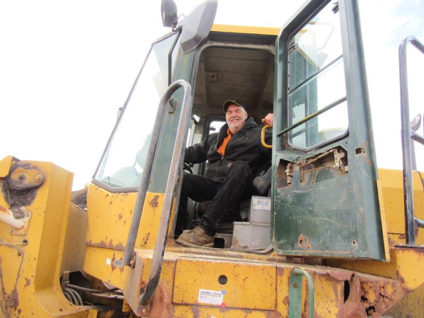 Mike Laribee of Laribee Equipment found this Kawasaki wheel loader provided a good spot from which to take in the Ashland auction.