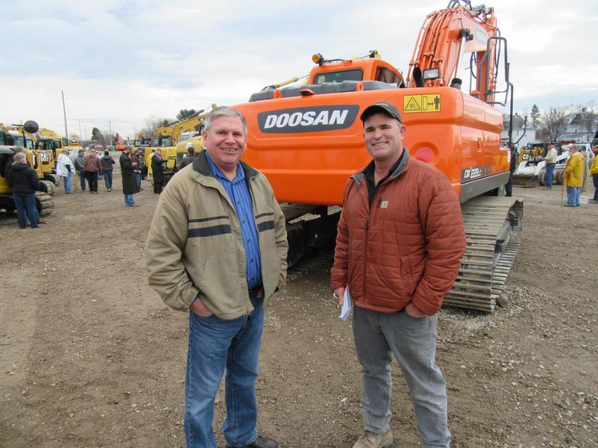 Gibson Machinery's Chuck Ruggles (L) caught up with Mark Haynes of Mark Haynes Construction at the Ashland auction.