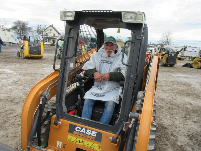 Duane Lutz of Lutz Custom Homes was pleased to have placed the winning bid on a Case SR130 wheeled skid steer at the Ashland auction for his son, Ryan Lutz of Committed Builders.