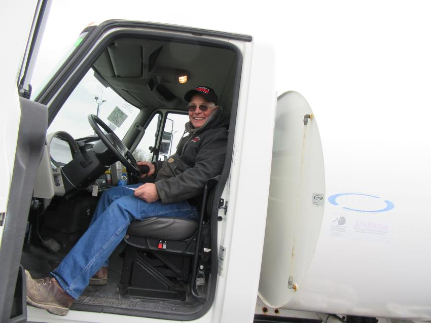 Ray Clouse of Clouse Construction considers a bid on this water truck at the Lima auction.