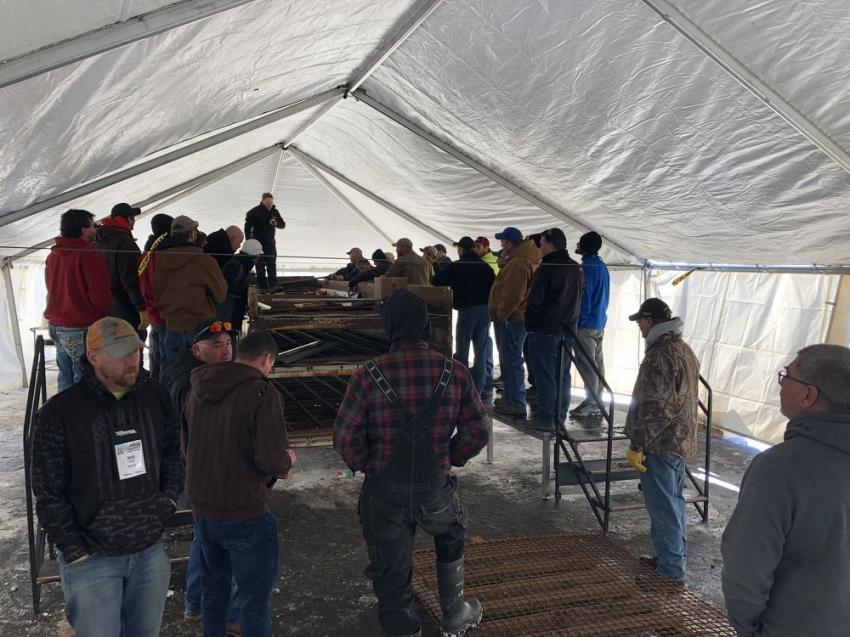 Guests attend a Major Wire screen class in an outdoor tent.