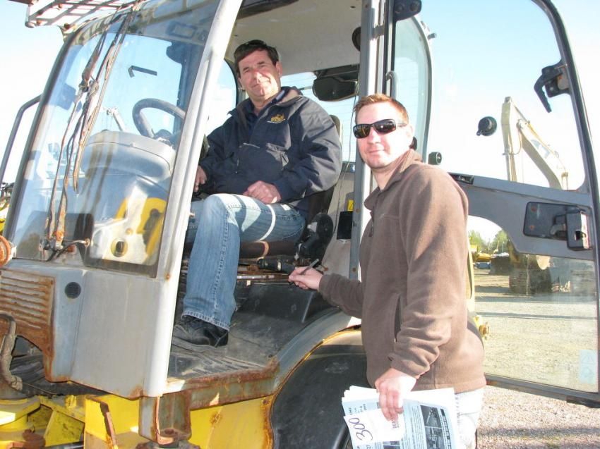 Test-operating a Wacker Neuson WL-36 compact wheel loader are John Chartrand (L) and Ken Chartrand of Chartrand Equipment, Red Bud, Ill.