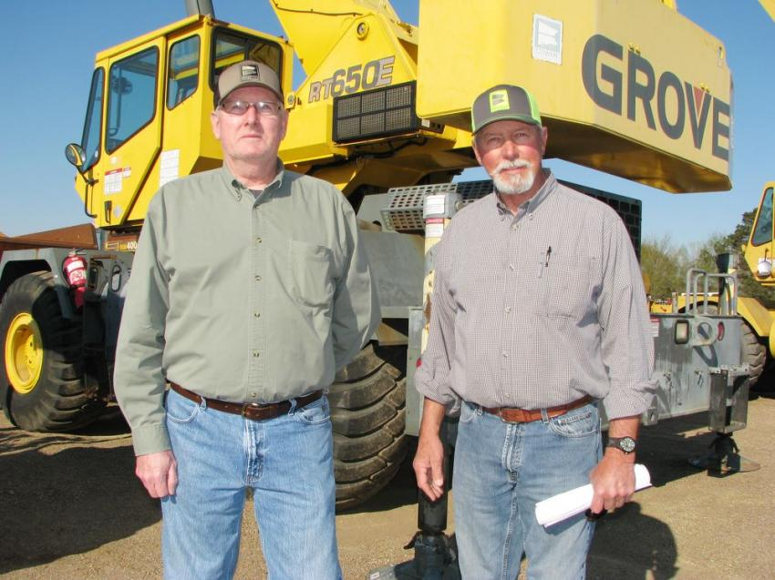 Looking over a 2001 Grove RT650E rough-terrain crane are Jess McHugh (L), retired sales representative of Cowin Equipment, the dealer that sold the machine when new, and his brother-in-law, John Garrison of Garrison Steel Erectors, Birmingham, Ala.