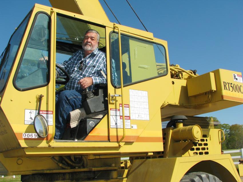 Testing out a Grove RT500C crane in the sale is Steve Woodard of Woodard Crane Service, Ozark, Ala.
