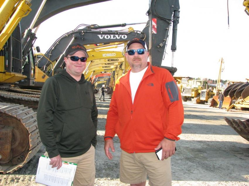 Looking over a stout selection of hydraulic excavators are Chase Jordan (L) and Andy Lipham of Down South Construction, Limeville, Ala.