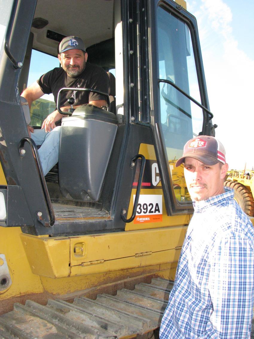 Test-operating a Cat 953C crawler loader are Zach Hinson (L) and Brandon Rowland of Hudgins Construction, McDonough, Ga.