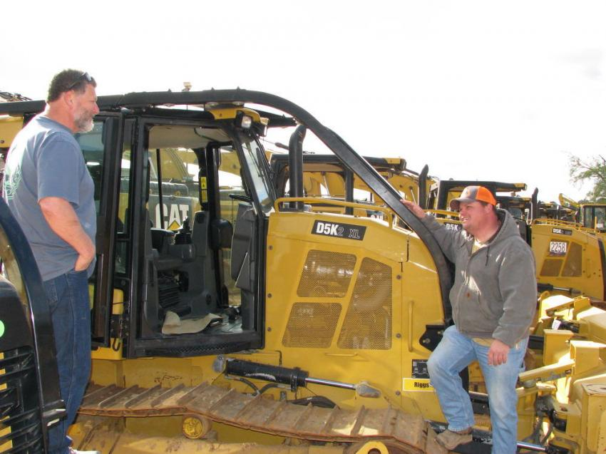 Deep in conversation about eight Cat D5K machines in the sale are Bob Chisenhall (L) and his nephew Curtis Chisenhall of Chisenhall Excavating, Fort Payne, Ala.
