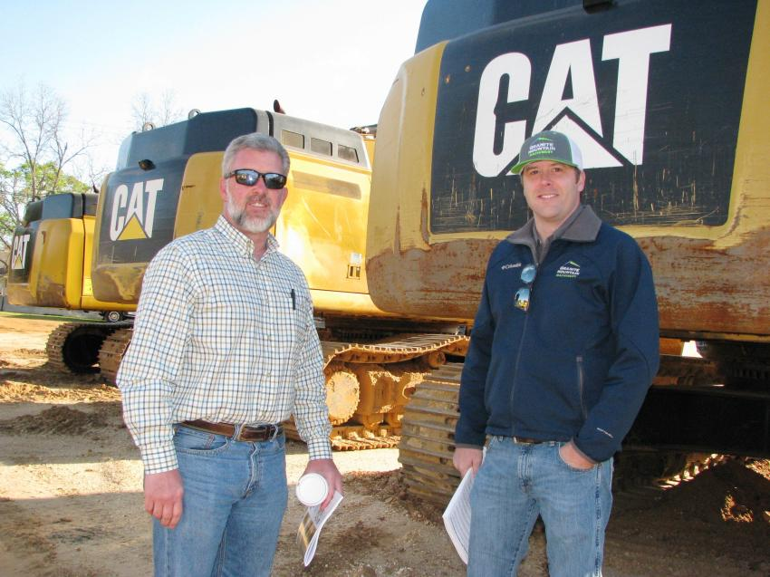 Looking over some of the big Cats are James King (L) and Caleb Phillips of Granite Mountain Machinery, Conyers, Ga.