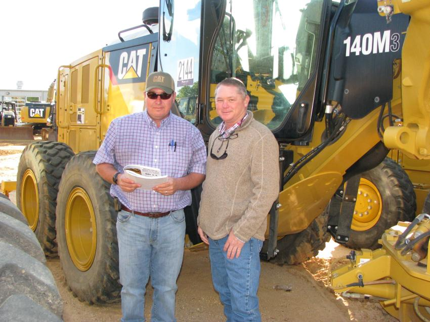 Some nice motorgraders, including several Cat 140M3s, piqued the interest of Cam Lanier (L) and Keith Bollendorf of Evergreen Construction, Opelika, Ala.
