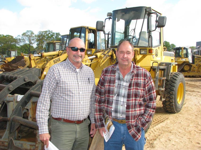 Tim Thomas (L) of Tractor & Equipment Co., Birmingham, Ala., and Rick Nesius of Talcon Group, Tallahassee, Fla., discuss the Komatsu machines of common interest.