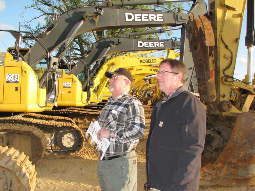 A lineup of excavators was of interest to John Waites (L) and J. E. Waites of John S. Waites & Sons Contractors, Talladega, Ala.