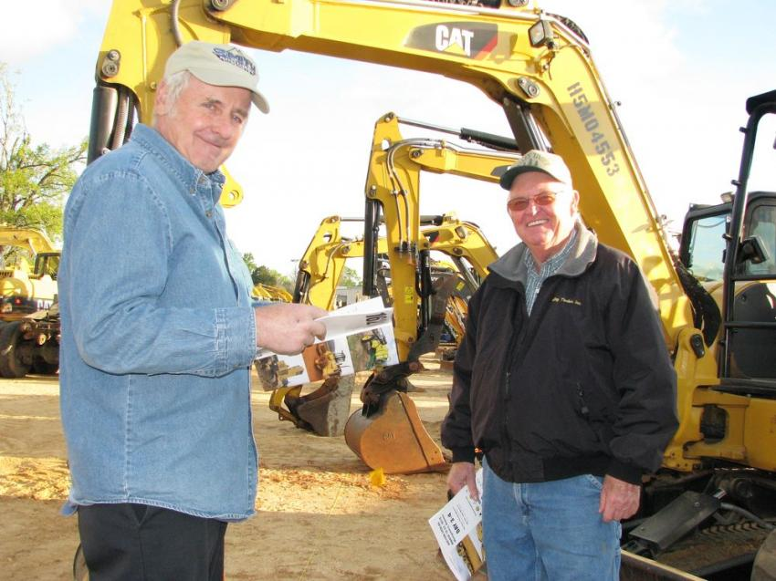 Looking over some of the mini-excavators are Danny Wagner (L) of Wagner Excavation, Fort Payne, Ala., and Jimmy Hester of Valley Timber, also based in Fort Payne, Ala.
