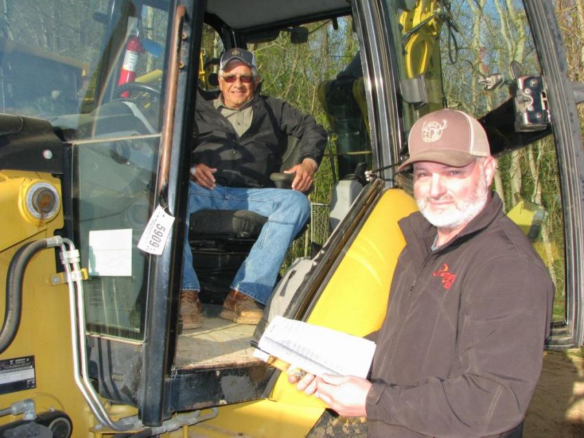 A couple of farmers talking about some of the backhoe loaders of common interest were Tony Sales (L), Poarch Creek Indians, Atmore, Ala., and Matt Johnson of Johnson Cattle Co., Brent, Ala.