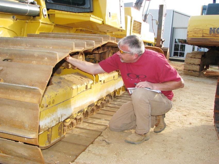 John Mullis of Mullis Trucking & Grading, Concord, N.C., checks out a John Deere 700K crawler tractor.