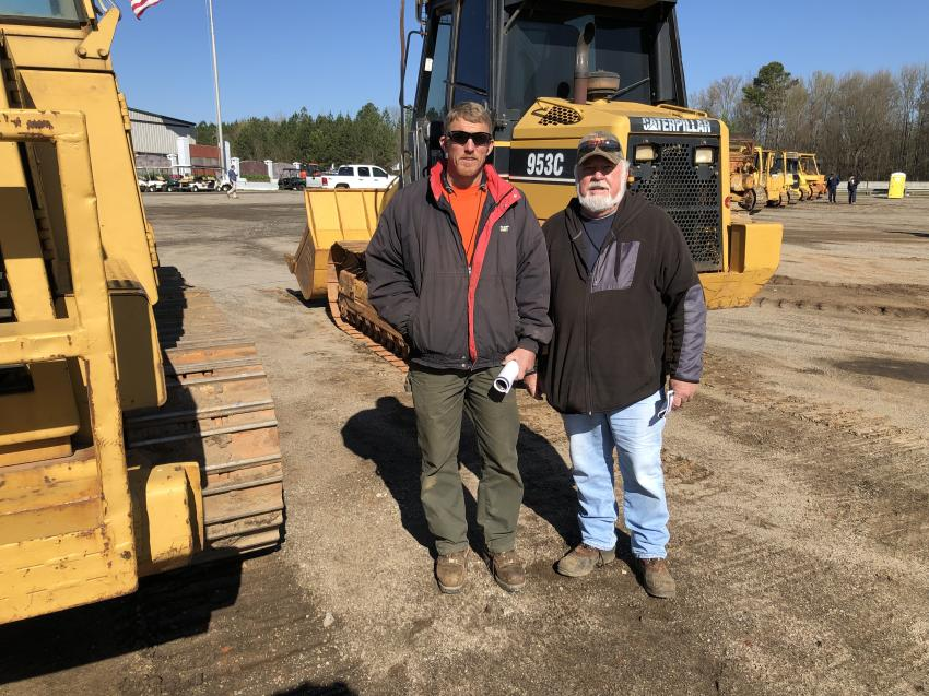 Looking over a Cat 953C crawler loader are Dale Epperson (L) and Larry Gilliland of Gilliland Grading in Hendersonville, N.C.