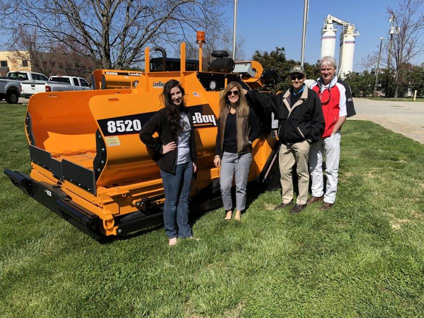 (L-R): Kaleigh Conroy of Ascendum Machinery; Kristi Harris and Jim Wagner of LeeBoy; and Mark Arcilesi of Ascendum gather around a LeeBoy 8520.