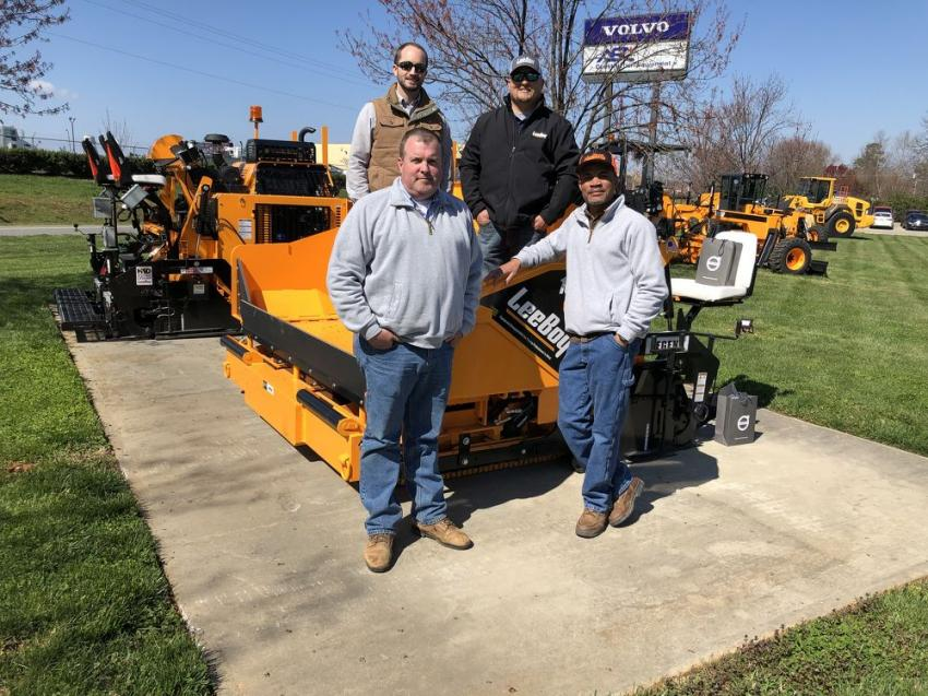 Going over the 8616C asphalt paver, which provides greater serviceability with easy-to-locate components, consistent material flow and a heavier screed for higher production yields, are (L-R back) Jesse King and Scott Lee of LeeBoy; and (L-R front) Steve Robbins and Lonnie Whittley of the Town of Huntersville, N.C.