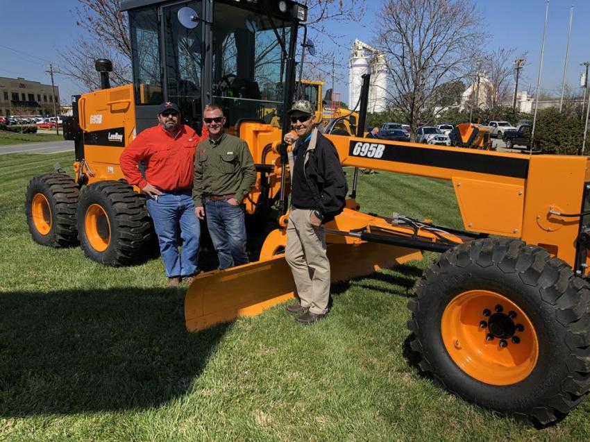 (L-R): Lawrence Heindl and Jeremy White of B&N Grading in Charlotte and Jim Wagner of LeeBoy pose with the LeeBoy 695B motorgrader, which provides precise performance and ruggedness in a time-tested design.