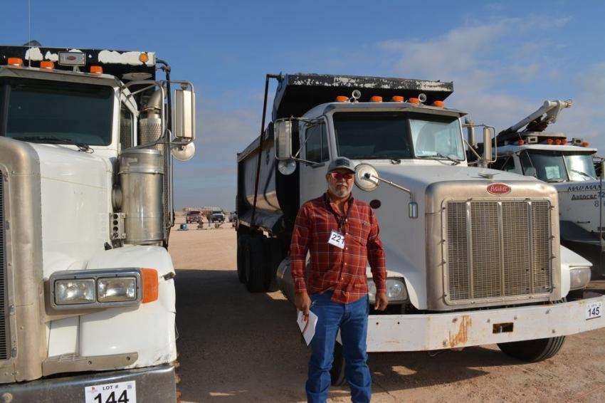 Rego Rodriguez of West Texas Construction was interested in trucks and he found a large selection for sale in Odessa. He bid on this Peterbilt dump along with other trucks.