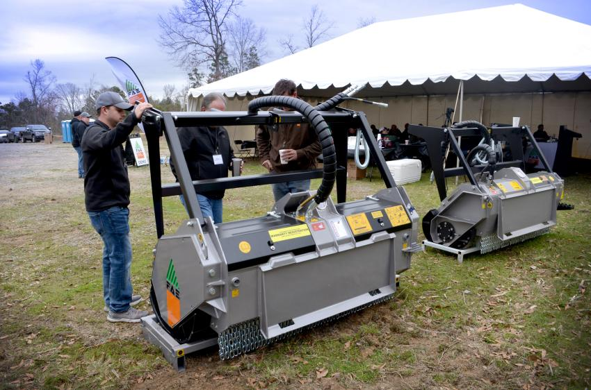 Guests look over the DML HY mulcher attachment during Texas Power Days.