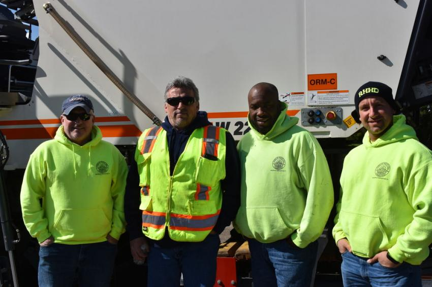 Many of Connecticut's townships are still laying down their own asphalt, rather than using private paving firms. (L-R) are Phil Brazalovich, Fred Weber, Duane Thomas and Roberto Leone, all of the town of Rocky Hill, Conn.