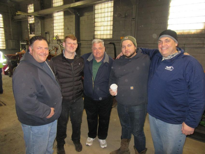 (L-R): Anthony Frato Sr. joins Matthew and Tim Sawicki, Anthony Jr. and Joe Frato to take in the auction activities.
