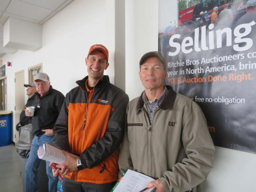 Casey Fencl (L) of Ritchie Bros. welcomes Larry Lindahl, president of Lindahl Brothers Inc., to the auction.