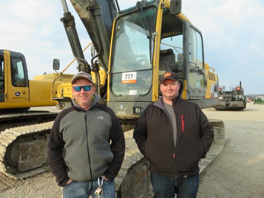 Seamus Curran (L) of Curran Excavation and Vince Malone of Celtic Services have a look at this Volvo EL330B excavator