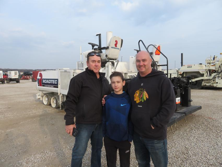 (L-R): The Yoss family — Bill, Xander and Nick — of Yoss Construction gather in front of a Roadtec RP190 paver.
